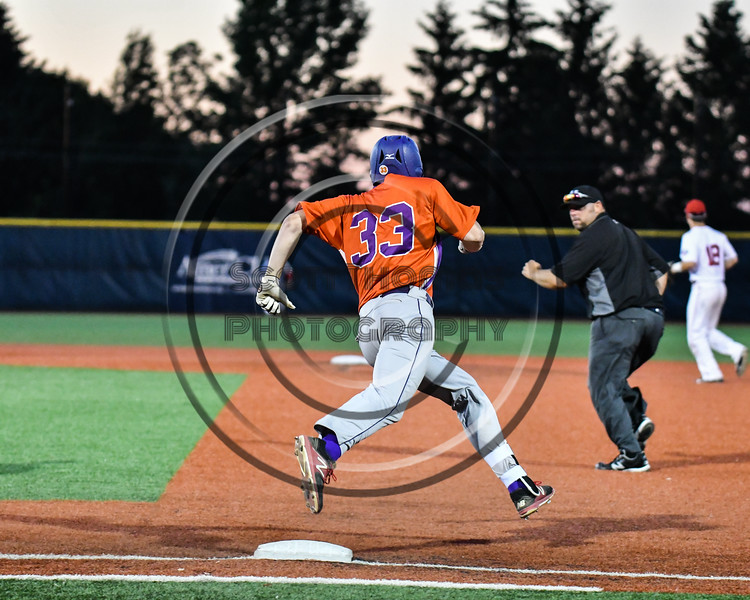 Cortland Crush Zach Kelley (33) rounds 1st Base after getting a hit against the Syracuse Salt Cats at OCC Turf Field in Syracuse, New York on Thursday, June 21, 2018. Syracuse won 6-2.