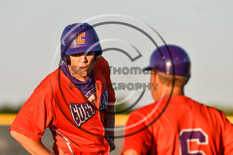 Cortland Crush Zach Kelley (33) getting instructins from Head Coach Bill McConnell (6) at 3rd Base against the Syracuse Salt Cats at OCC Turf Field in Syracuse, New York on Thursday, June 21, 2018. Syracuse won 6-2.