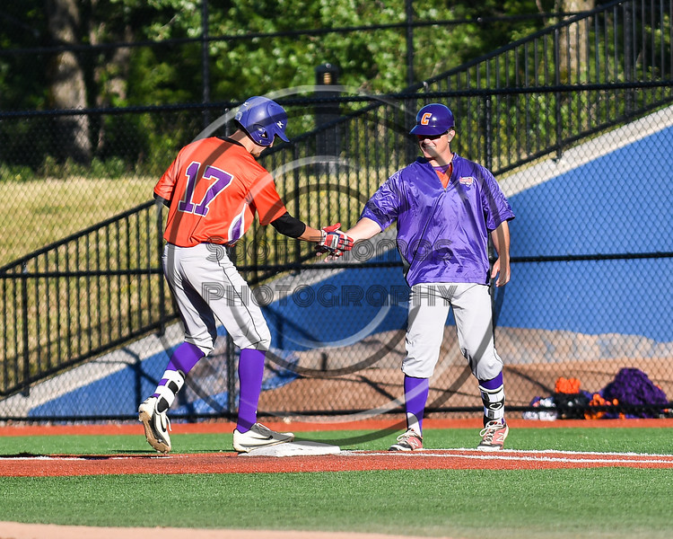 Cortland Crush Assistant and First Base Coach Connor Griffin (28) congratulating Jimmy Tatum (17) for reaching 1st Base against the Syracuse Salt Cats at OCC Turf Field in Syracuse, New York on Thursday, June 21, 2018. Syracuse won 6-2.