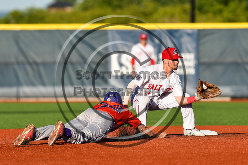 Syracuse Salt Cats Michael Gorman (3) about to tag Cortland Crush Zach Kelley (33) out at 2nd Base at OCC Turf Field in Syracuse, New York on Thursday, June 21, 2018. Syracuse won 6-2.