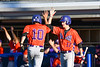 Cortland Crush Jimmy Tatum (17) giving Nelson Laviosa (10) a High Five after Laviosa scored a rund against the Syracuse Salt Cats at OCC Turf Field in Syracuse, New York on Thursday, June 21, 2018. Syracuse won 6-2.