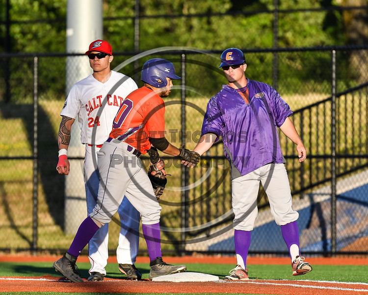 Cortland Crush Assistant and First Base Coach Connor Griffin (28) congratulating Nelson Laviosa (10) for reaching 1st Base against the Syracuse Salt Cats at OCC Turf Field in Syracuse, New York on Thursday, June 21, 2018. Syracuse won 6-2.