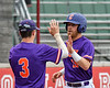 Cortland Crush Justin Valentino (15) gets a High Five from Anthony Cieszko (3) after scoring a run against the Rome Generals on Wallace Field in Cortland, New York on Sunday, June 23, 2018. Cortland won 14-5.