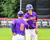 Cortland Crush Jimmy Tatum (17) gets a fist bump from Head Coach Bill McConnell (6) in the game against the Rome Generals on Wallace Field in Cortland, New York on Sunday, June 23, 2018. Cortland won 14-5.