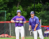 Cortland Crush Hayden Houts (5) talking with Assistant and First Base Coach Connor Griffin (28) at 1st Base against the Rome Generals on Wallace Field in Cortland, New York on Sunday, June 23, 2018. Cortland won 14-5.