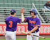 Cortland Crush Alex Babcock (16) gets a High Five from Anthony Cieszko (3) after scoring a run against the Rome Generals on Wallace Field in Cortland, New York on Sunday, June 23, 2018. Cortland won 14-5.