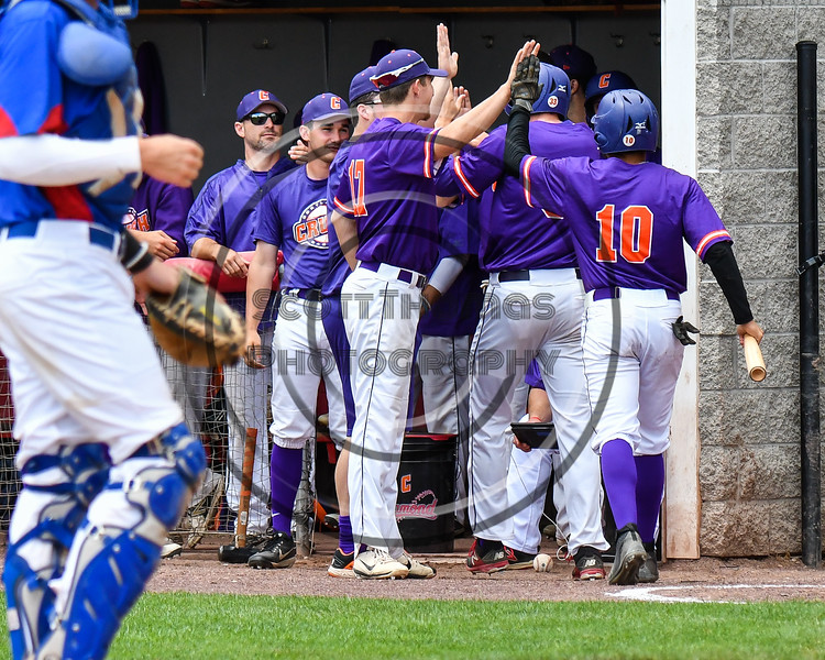 Cortland Crush players greet Nelson Laviosa (10) after he scored against the Rome Generals on Wallace Field in Cortland, New York on Sunday, June 23, 2018. Cortland won 14-5.