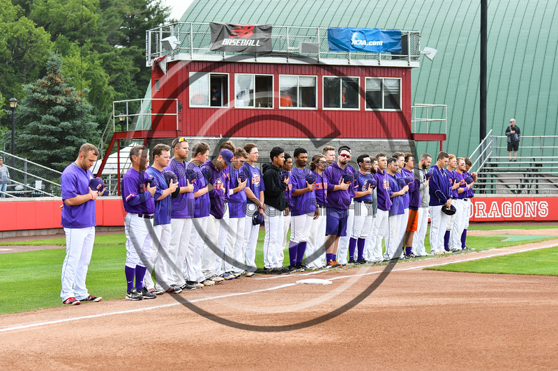 Cortland Crush players standing for the National Anthem before playing the Rome Generals on Wallace Field in Cortland, New York on Sunday, June 23, 2018.