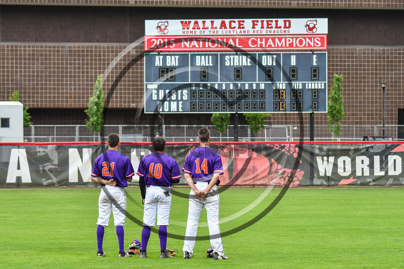 Cortland Crush players Joe Palmo (21, Nelson Laviosa (10) and Dylan Ketch (14) stand for the National Anthem before playing  the Rome Generals on Wallace Field in Cortland, New York on Sunday, June 23, 2018.