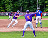 Cortland Crush Head Coach Bill McConnell (6) waving in runners against the Rome Generals on Wallace Field in Cortland, New York on Sunday, June 23, 2018. Cortland won 14-5.