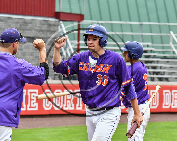 Cortland Crush Zach Kelley (33) after scoring a run against the Rome Generals on Wallace Field in Cortland, New York on Sunday, June 23, 2018. Cortland won 14-5.