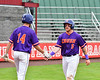 Cortland Crush Hayden Houts (5) gets congratulated by Dylan Ketch (14) after scoring a run against the Rome Generals on Wallace Field in Cortland, New York on Sunday, June 23, 2018. Cortland won 14-5.