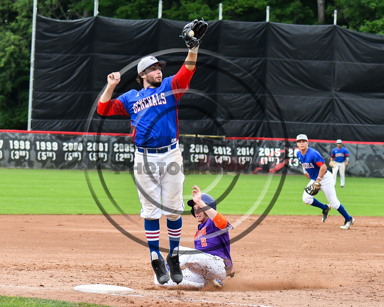 Cortland Crush Alex Flock (2) slides into 3rd Base against Rome Generals Thomas Diskin (13) on Wallace Field in Cortland, New York on Sunday, June 23, 2018. Cortland won 14-5.
