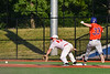 Cortland Crush Zach Kelley (33) is out at 1st Base as Onondaga Flames Trace Peterson (17) stretches out for the ball at OCC Turf Field in Syracuse, New York on Saturday, June 30, 2018. Onondaga won 9-7.