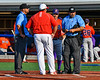 Cortland Crush Head Coach Bill McConnell (6) going over field rules with Onondaga Flames coach and Umpires at OCC Turf Field in Syracuse, New York on Saturday, June 30, 2018.