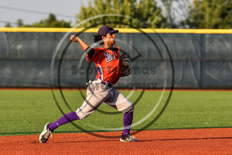 Cortland Crush Iset Maldonado (1) about to throw out the Onondaga Flames runner at 1st Base at OCC Turf Field in Syracuse, New York on Saturday, June 30, 2018. Onondaga won 9-7.