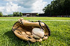 Baseball in glove on Wallace Field in Cortland, New York on Wednesday, July 4, 2018.