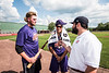 Jake Hitt interviewing Cortland Crush Justin Pacheco (4) while Alex Larson (26) uses a bat mic at Wallace Field in Cortland, New York on Wednesday, July 4, 2018.