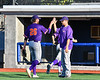 Cortland Crush Pitching Coach Tyler Mattoon (41) greets Alex Larson (26) after an inning against the Onondaga Flames at OCC Turf Field in Syracuse, New York on Thursday, July 19, 2018. Onondaga won 6-2.