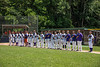 Cortland Crush coaches and players stand for the National Antherm on Greg's Field at Beaudry Park in Cortland, New York on Sunday, July 22, 2018.