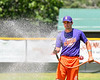 Cortland Crush Maxwell Tannebaum (23) watering the infield before a game against the Onondaga Flames on Greg's Field at Beaudry Park in Cortland, New York on Sunday, July 22, 2018.