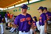 Cortland Crush Drew Boli (40) working limbering up in the dugout at the Gutchess Lumber Sports Complex in Cortland, New York on Saturday, June 8, 2019.