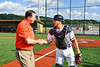 Cortland Crush Catcher Dylan Nolan (14) greets sponsor after the First Pitch before a New York Collegiate Baseball League game at Gutchess Lumber Sports Complex in Cortland, New York on Friday, June 14, 2019.