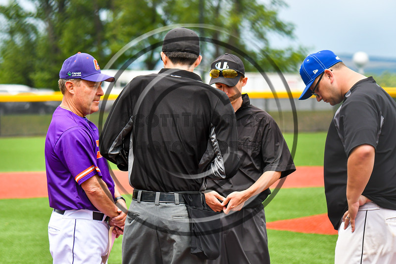 Cortland Crush Head Coach Bill McConnell (6) going over the ground rules with the umpires and Rome Generals Manager before a New York Collegiate Baseball League game at Gutchess Lumber Sports Complex in Cortland, New York on Saturday, June 15, 2019.