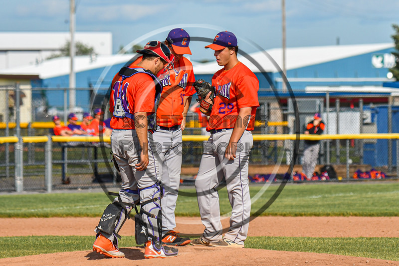Cortland Crush Pitching Coach Ryan Stevens (13) conferences with Dylan Nolan (14) and Michael Viveiros (29) on the mound against the Rome Generals in New York Collegiate Baseball League action at Larry Delutis Field in Rome, New York on Saturday, June 22, 2019. Cortland won 16-9.