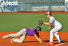 Cortland Crush Dylan Nolan (14) dives back to First Base against the Syracuse Salt Cats in New York Collegiate Baseball League action at OCC Turf Field in Syracuse, New York on Saturday, June 29, 2019. Cortland won 4-1.