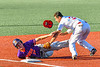 Cortland Crush Alex Flock (10) gets tagged out at Thrid Base by Syracuse Salt Cats Jonnathan Cepeda (3) in New York Collegiate Baseball League action at OCC Turf Field in Syracuse, New York on Saturday, June 29, 2019. Cortland won 4-1.