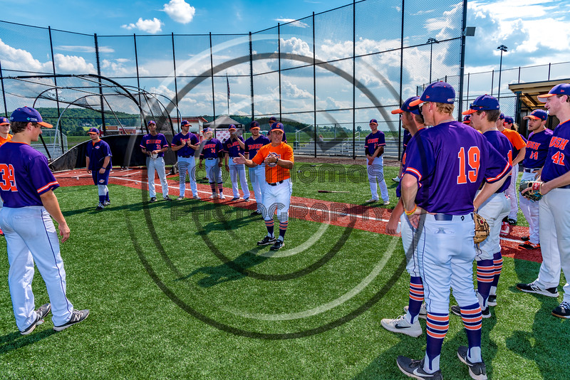Cortland Crush Head Coach Bill McConnell (6) talking to his team before playing the Sherrill Silversmiths in a New York Collegiate Baseball League game at Gutchess Lumber Sports Complex in Cortland, New York on Thursday, July 4, 2019.