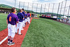 Cortland Crush players and coaches standing for the National Anthem before a New York Collegiate Baseball League game at Gutchess Lumber Sports Complex in Cortland, New York on Thursday, July 4, 2019.