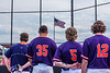 Cortland Crush Pitching Coach Ryan Stevens (13) and players Brad Nowak (35), Hayden Houts (5) and Max Flock (12) standing for the National Anthem before a New York Collegiate Baseball League game at Gutchess Lumber Sports Complex in Cortland, New York on Thursday, July 4, 2019.