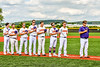 Cortland Crush coaches and players stand for the National Anthem before playing the Sherrill Silversmiths in a New York Collegiate Baseball League game at Gutchess Lumber Sports Complex in Cortland, New York on Thursday, July 21, 2019.