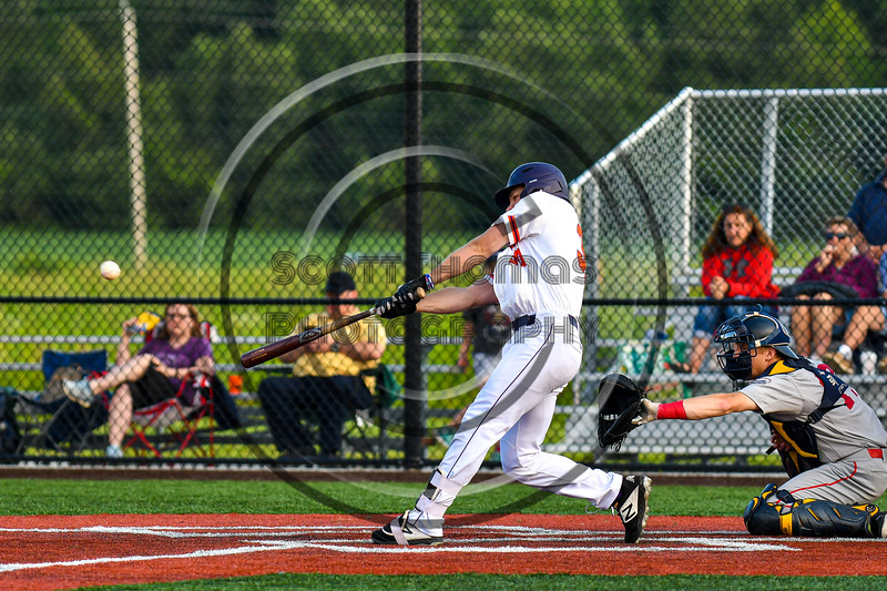 Cortland Crush Stephen Bennett (30) hits the ball against the Syracuse Salt Cats in New York Collegiate Baseball League playoff action at Gutchess Lumber Sports Complex in Cortland, New York on Thursday, July 24, 2019. Cortland won 1-0 in extra innings.