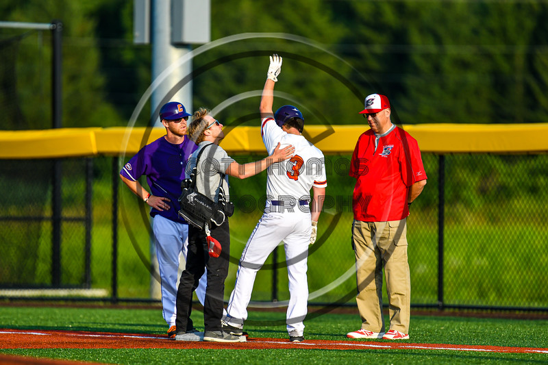 Cortland Crush Athletic Trainer Anthony Spinelli checks on Anthony Cieszko (3) at First Base against the Syracuse Salt Cats in New York Collegiate Baseball League playoff action at Gutchess Lumber Sports Complex in Cortland, New York on Thursday, July 24, 2019. Cortland won 1-0 in extra innings.