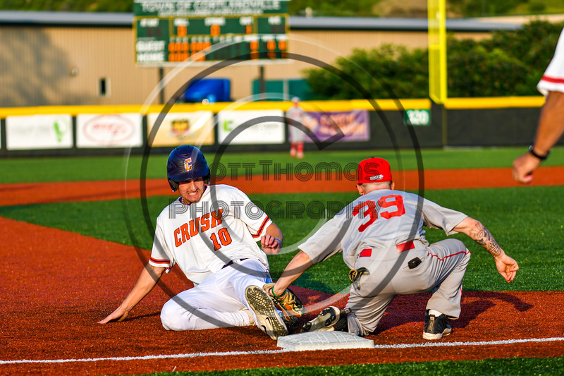 Cortland Crush Alex Flock (10) slides safe into Third Base against Syracuse Salt Cats Rocco Leone (39) in New York Collegiate Baseball League playoff action at Gutchess Lumber Sports Complex in Cortland, New York on Thursday, July 24, 2019. Cortland won 1-0 in extra innings.