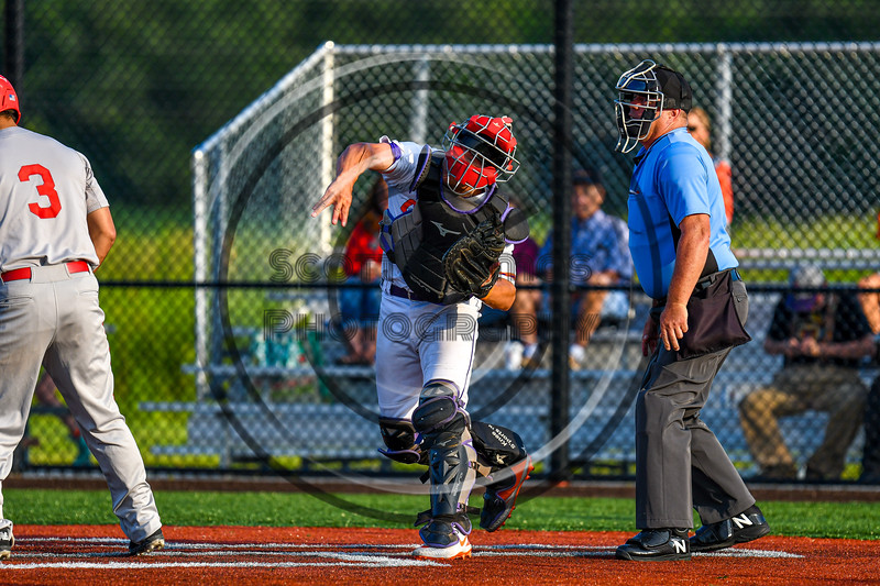 Cortland Crush Dylan Nolan (14) throwing the ball to Third Base for an out against the Syracuse Salt Cats in New York Collegiate Baseball League playoff action at Gutchess Lumber Sports Complex in Cortland, New York on Thursday, July 24, 2019. Cortland won 1-0 in extra innings.
