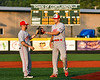 Syracuse Salt Cats Jonnathan Cepeda (3) greets incoming pitcher Chase Nowak (25) in New York Collegiate Baseball League playoff game against the Cortland Crush at Gutchess Lumber Sports Complex in Cortland, New York on Thursday, July 24, 2019. Cortland won 1-0 in extra innings.