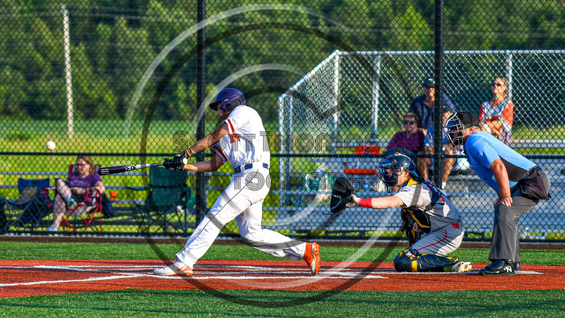 Cortland Crush Dylan Nolan (14) hits the ball against the Syracuse Salt Cats in New York Collegiate Baseball League playoff action at Gutchess Lumber Sports Complex in Cortland, New York on Thursday, July 24, 2019. Cortland won 1-0 in extra innings.