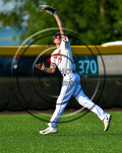 Cortland Crush Alex Flock (10) snags a fly ball for an out against the Syracuse Salt Cats in New York Collegiate Baseball League playoff action at Gutchess Lumber Sports Complex in Cortland, New York on Thursday, July 24, 2019. Cortland won 1-0 in extra innings.