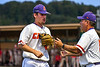 Cortland Crush Head Coach Bill McConnell (6) greets Pitcher Garrett Bell (41) after an inning against the Syracuse Salt Cats in New York Collegiate Baseball League playoff action at Gutchess Lumber Sports Complex in Cortland, New York on Thursday, July 24, 2019. Cortland won 1-0 in extra innings.