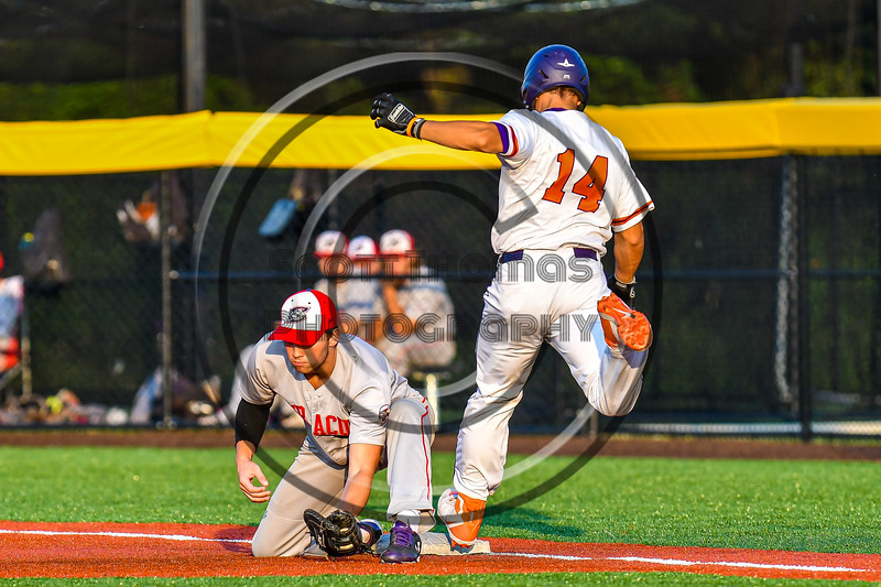 Cortland Crush Dylan Nolan (14) is thrown out at First Base against the Syracuse Salt Cats in New York Collegiate Baseball League playoff action at Gutchess Lumber Sports Complex in Cortland, New York on Thursday, July 24, 2019. Cortland won 1-0 in extra innings.
