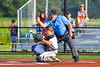 Home Plate Umpire calls a strike behind Cortland Crush Catcher Dylan Nolan (14) against the Syracuse Salt Cats in New York Collegiate Baseball League playoff action at Gutchess Lumber Sports Complex in Cortland, New York on Thursday, July 24, 2019. Cortland won 1-0 in extra innings.