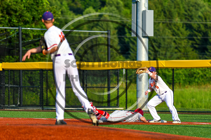 Cortland Crush Hayden Houts (5) holding the Syracuse Salt Cats runner at First Base in New York Collegiate Baseball League playoff action at Gutchess Lumber Sports Complex in Cortland, New York on Thursday, July 24, 2019. Cortland won 1-0 in extra innings.