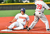 Cortland Crush Dylan Nolan (14) slides safe into Third Base against the Syracuse Salt Cats in New York Collegiate Baseball League playoff action at Gutchess Lumber Sports Complex in Cortland, New York on Thursday, July 24, 2019. Cortland won 1-0 in extra innings.