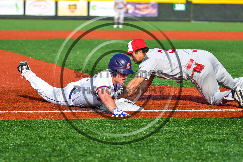 Cortland Crush Garrett Callghan (15) slides safe into Third Base against the Syracuse Salt Cats in New York Collegiate Baseball League playoff action at Gutchess Lumber Sports Complex in Cortland, New York on Thursday, July 24, 2019. Cortland won 1-0 in extra innings.