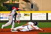 Syracuse Salt Cats Xander Ferlenda (18) throws over Cortland Crush Dylan Nolan (14) and completing a Double Play in New York Collegiate Baseball League playoff action at Gutchess Lumber Sports Complex in Cortland, New York on Thursday, July 24, 2019. Cortland won 1-0 in extra innings.