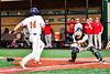 Cortland Crush Dylan Nolan (14) atempts to scores but is blocked and tagged out by Syracuse Salt Cats Catcher Connor Suech (17) in New York Collegiate Baseball League playoff action at Gutchess Lumber Sports Complex in Cortland, New York on Thursday, July 24, 2019. Cortland won 1-0 in extra innings.